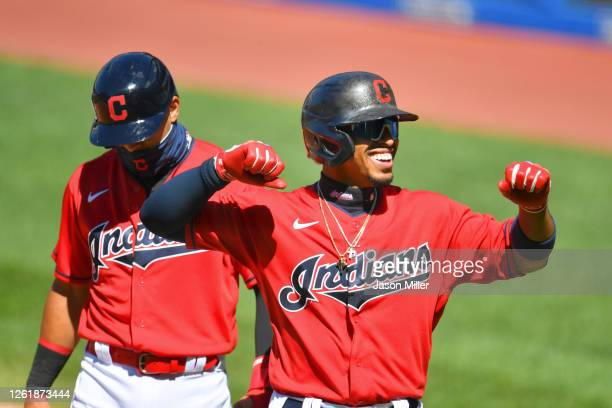Cesar Hernandez follows Francisco Lindor of the Cleveland Indians after both scored on a homer by Lindor during the first inning of game 1 of a...