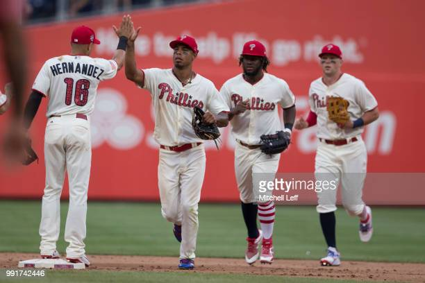 Cesar Hernandez Nick Williams Odubel Herrera and Rhys Hoskins of the Philadelphia Phillies high five after the game against the Baltimore Orioles at...