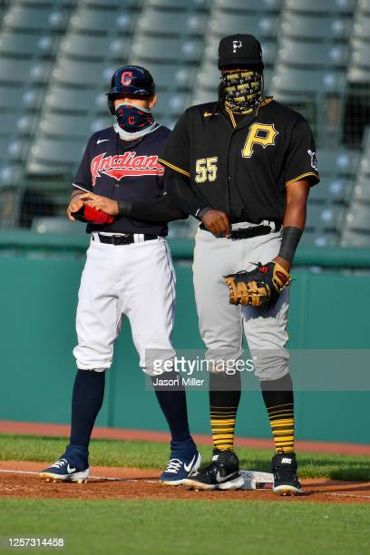 Cesar Hernandez of the Cleveland Indians and first baseman Josh Bell of the Pittsburgh Pirates both stand on first during the first inning at...