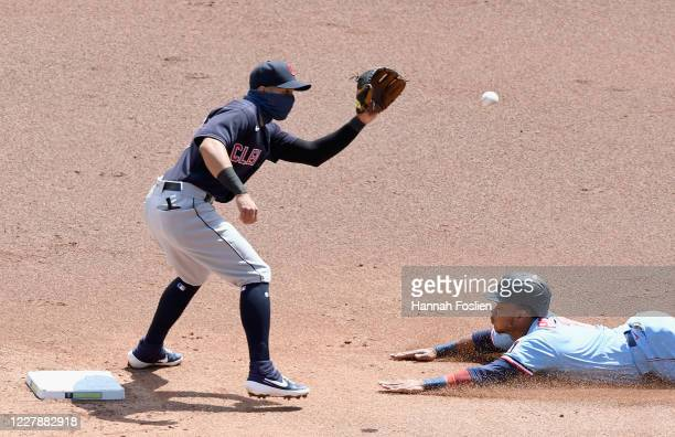 Cesar Hernandez of the Cleveland Indians catches Jorge Polanco of the Minnesota Twins stealing second base during the first inning of the game at...