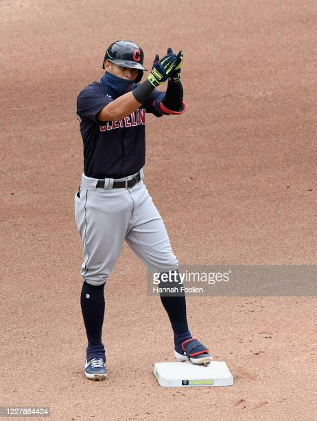 Cesar Hernandez of the Cleveland Indians celebrates a double against the Minnesota Twins during the fourth inning of the game at Target Field on...