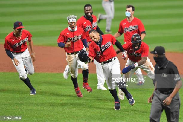 Cesar Hernandez of the Cleveland Indians celebrates with his teammates after hitting a walk-off RBI single during the ninth inning against the...