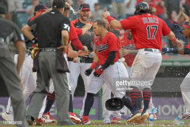 Cesar Hernandez of the Cleveland Indians celebrates with teammates after hitting a walk-off two run homer during the tenth inning to defeat the...