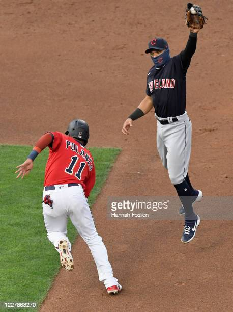 Cesar Hernandez of the Cleveland Indians fields a throw as Jorge Polanco of the Minnesota Twins attempts to advance to second base during the second...
