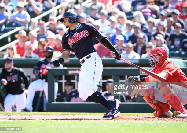 Cesar Hernandez of the Cleveland Indians follows through on a swing against the Los Angeles Angels during a spring training game at Goodyear Ballpark...
