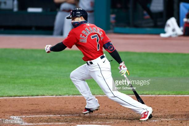 Cesar Hernandez of the Cleveland Indians hits an RBI single against relief pitcher Michael Lorenzen of the Cincinnati Reds in the fifth inning at...