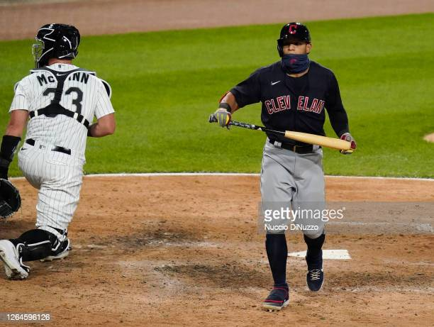 Cesar Hernandez of the Cleveland Indians reacts after striking out during the ninth inning of a game against the Chicago White Sox on August 07 2020...