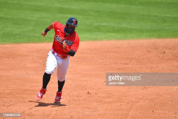 Cesar Hernandez of the Cleveland Indians rounds second on his way to score off a hit by Jose Ramirez during the third inning against the Kansas City...