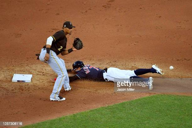 Cesar Hernandez of the Cleveland Indians steals second as shortstop Erik Gonzalez of the Pittsburgh Pirates waits for the throw during the fifth...