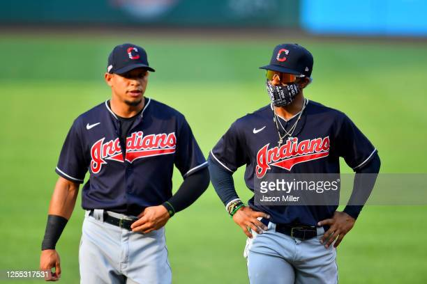 Cesar Hernandez of the Cleveland Indians talks with Francisco Lindor prior to an intrasquad game during summer workouts at Progressive Field on July...