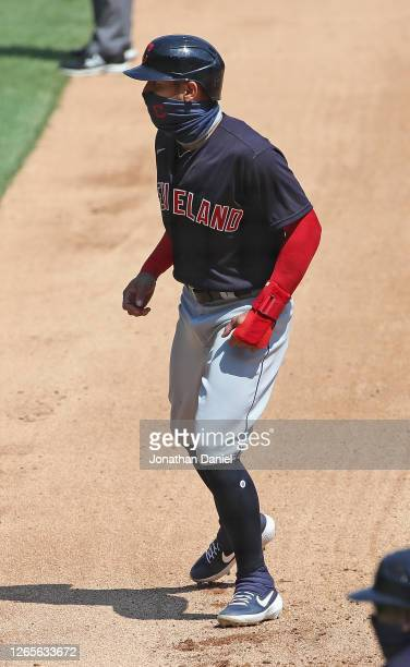 """Cesar Hernandez of the Cleveland Indians wears a """"neck gaiter"""" mask as he plays against the Chicago White Sox at Guaranteed Rate Field on August 08,..."""