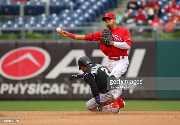 Cesar Hernandez of the Philadelphia Phillies attempts to turn a doubleplay in the fourth inning during a game against the Colorado Rockies at...