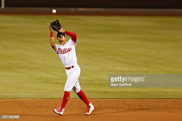 Cesar Hernandez of the Philadelphia Phillies catches a fly ball hit by Daniel Murphy of the Washington Nationals in the ninth inning of the game at...
