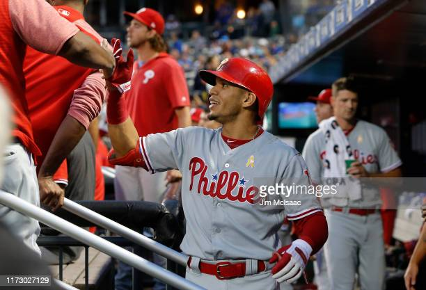 Cesar Hernandez of the Philadelphia Phillies celebrates his first inning home run against the New York Mets with his teammates in the dugout at Citi...