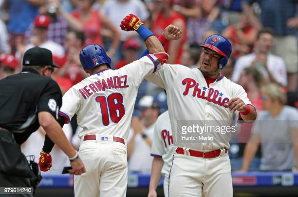 Cesar Hernandez of the Philadelphia Phillies celebrates with Jorge Alfaro after hitting a tworun home run in the fourth inning during a game against...