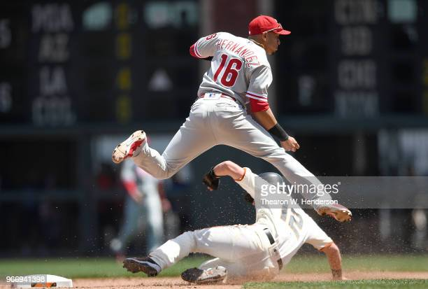 Cesar Hernandez of the Philadelphia Phillies completes the doubleplay throwing over the top of Joe Panik of the San Francisco Giants in the bottom of...