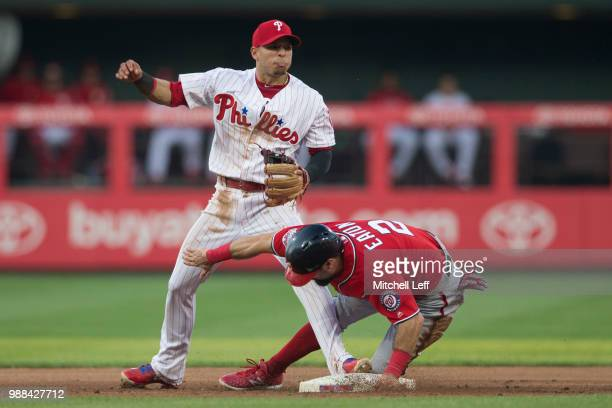 Cesar Hernandez of the Philadelphia Phillies forces out Adam Eaton of the Washington Nationals in the top of the fifth inning at Citizens Bank Park...