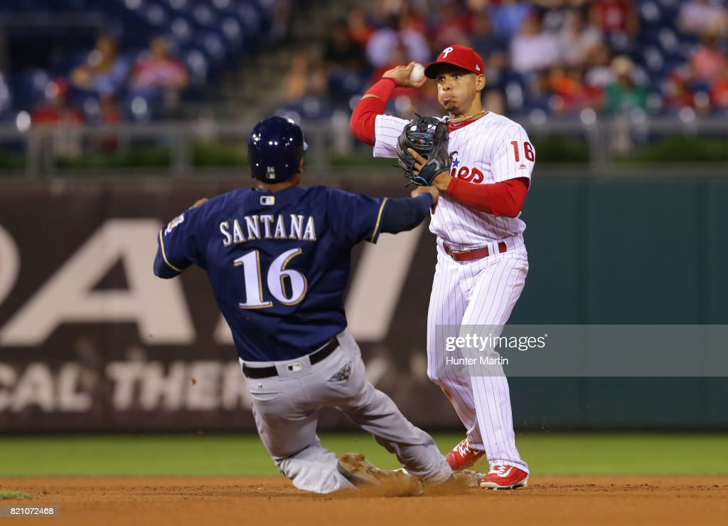 Cesar Hernandez #16 of the Philadelphia Phillies forces out Domingo Santana #16 of the Milwaukee Brewers at second base as he turns a double-play in the seventh inning during a game at Citizens Bank Park on July 22, 2017 in Philadelphia, Pennsylvania. The Brewers won 9-8.