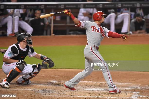 Cesar Hernandez of the Philadelphia Phillies hits a triple during the fourth inning against the Miami Marlins at Marlins Park on July 15 2018 in...