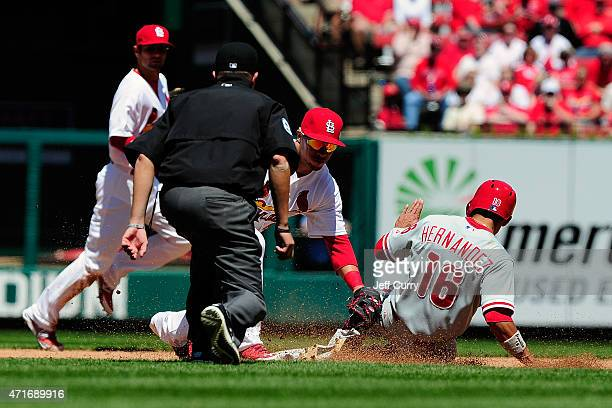 Cesar Hernandez of the Philadelphia Phillies is caught stealing by Kolten Wong of the St Louis Cardinals during the third inning at Busch Stadium on...