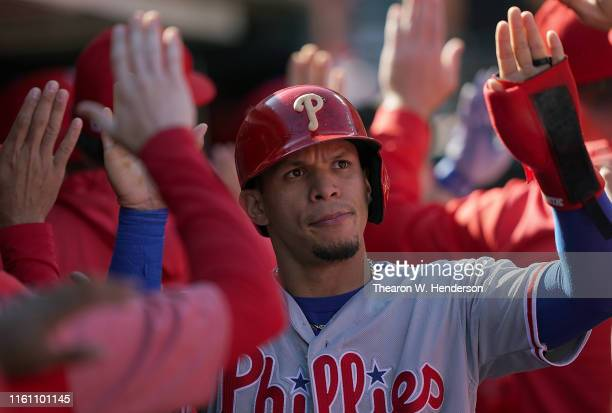 Cesar Hernandez of the Philadelphia Phillies is congratulated by teammates after he scored against the San Francisco Giants in the top of the second...