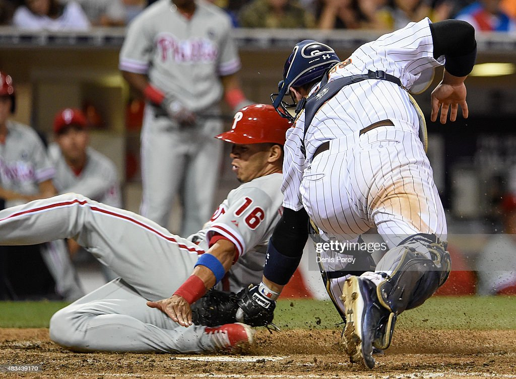 Cesar Hernandez #16 of the Philadelphia Phillies is tagged out at the plate by Derek Norris #3 of the San Diego Padres during the eighth inning of a baseball game at Petco Park August 8, 2015 in San Diego, California.