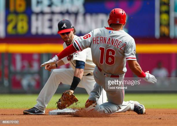 Cesar Hernandez of the Philadelphia Phillies is tagged out by Dansby Swanson of the Atlanta Braves attempting to steal second in the first inning of...