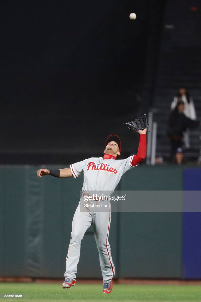 Cesar Hernandez #16 of the Philadelphia Phillies leaps to make a catch during the ninth inning against the San Francisco Giants at AT&T Park on August 19, 2017 in San Francisco, California. The Phillies defeated the Giants 12-9.