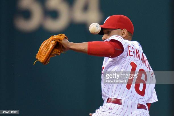 Cesar Hernandez of the Philadelphia Phillies makes an error in the second inning against the Colorado Rockies at Citizens Bank Park on May 28 2014 in...