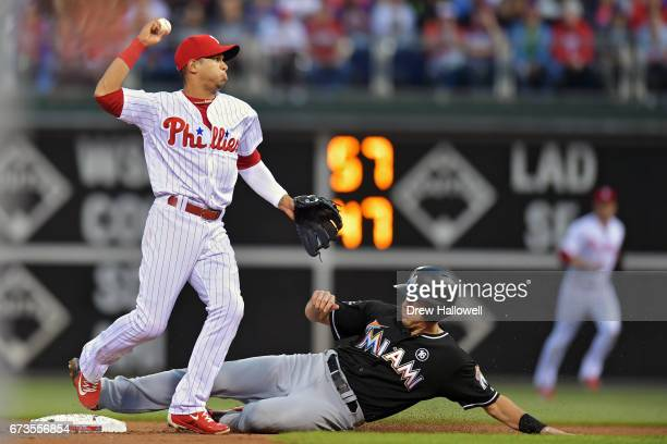 Cesar Hernandez of the Philadelphia Phillies puts out JT Realmuto of the Miami Marlins on an attempted double play in the second inning at Citizens...