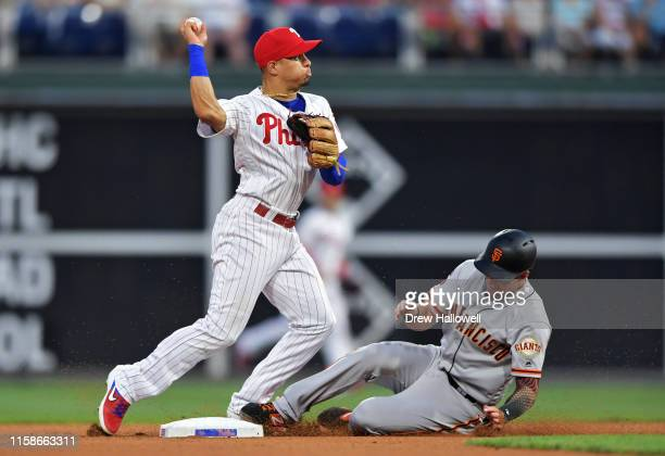 Cesar Hernandez of the Philadelphia Phillies puts out Mike Yastrzemski of the San Francisco Giants at second base in the fourth inning at Citizens...