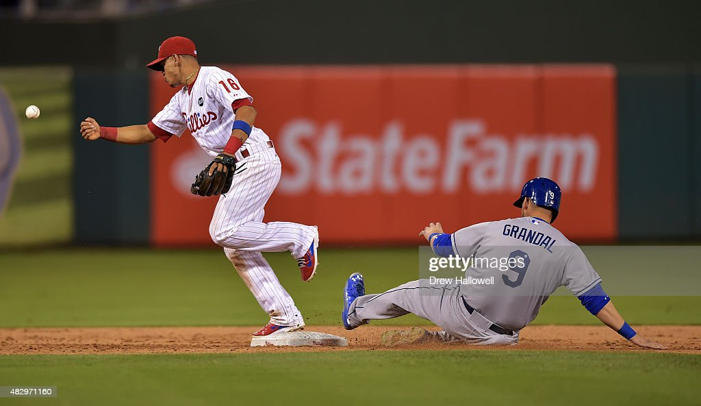 Cesar Hernandez #16 of the Philadelphia Phillies puts out Yasmani Grandal #9 of the Los Angeles Dodgers at second base but loses the ball on the transfer for a double play in the eighth inning at Citizens Bank Park on August 4, 2015 in Philadelphia, Pennsylvania.