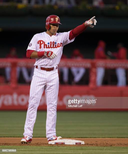 Cesar Hernandez of the Philadelphia Phillies reacts after hitting a double in the bottom of the first inning against the Washington Nationals at...