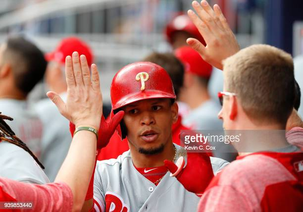 Cesar Hernandez of the Philadelphia Phillies reacts after hitting a solo homer in the sixth inning against the Atlanta Braves at SunTrust Park on...