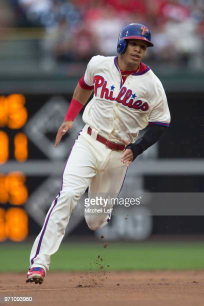 Cesar Hernandez of the Philadelphia Phillies runs to third base on an error by the Milwaukee Brewers in the bottom of the first inning at Citizens...