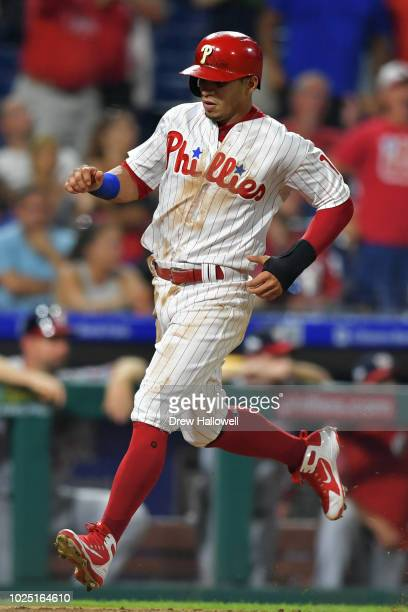 Cesar Hernandez of the Philadelphia Phillies scores in the seventh inning against the Washington Nationals at Citizens Bank Park on August 29 2018 in...