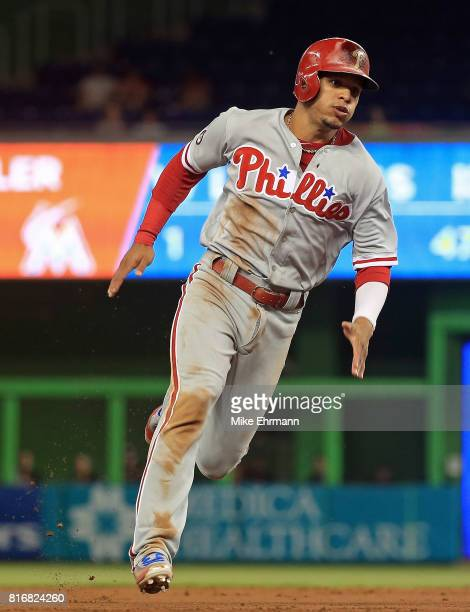Cesar Hernandez of the Philadelphia Phillies scores on a two RBI double by Maikel Franco in the third inning during a game against the Miami Marlins...