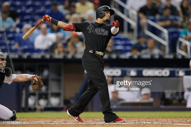 Cesar Hernandez of the Philadelphia Phillies singles in the sixth inning against the Miami Marlins at Marlins Park on August 25 2019 in Miami Florida...