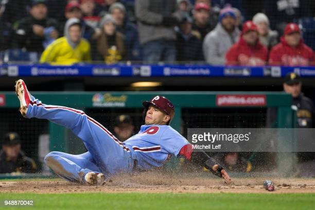 Cesar Hernandez of the Philadelphia Phillies slides home safely to score a run on an RBI single hit by Odubel Herrera in the bottom of the second...