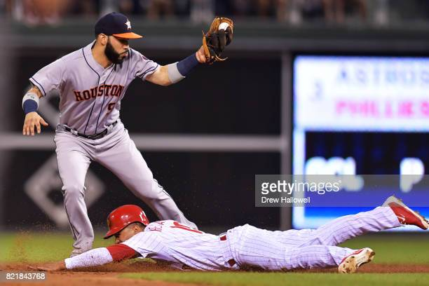 Cesar Hernandez of the Philadelphia Phillies slides safe under the tag of Marwin Gonzalez of the Houston Astros on a steal in the third inning at...
