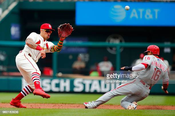 Cesar Hernandez of the Philadelphia Phillies steals second base against Kolten Wong of the St Louis Cardinals in the third inning at Busch Stadium on...