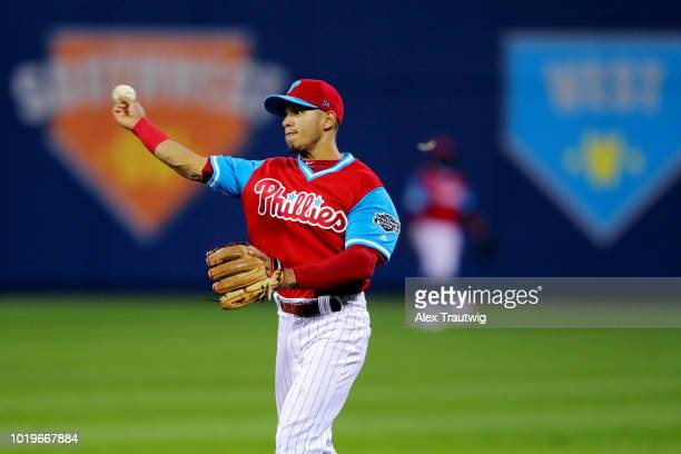 Cesar Hernandez of the Philadelphia Phillies throws the ball around the infield during the 2018 Little League Classic against the New York Mets at...