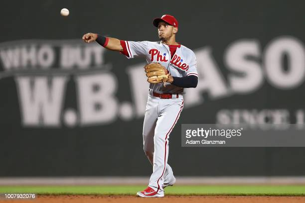Cesar Hernandez of the Philadelphia Phillies throws to first base in the seventh inning of a game against the Boston Red Sox at Fenway Park on July...