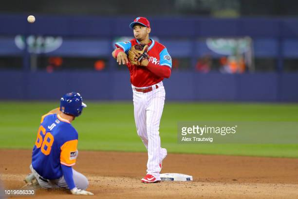 Cesar Hernandez of the Philadelphia Phillies turns a double play as Jeff McNeil of the New York Mets slides into second base during the 2018 Little...