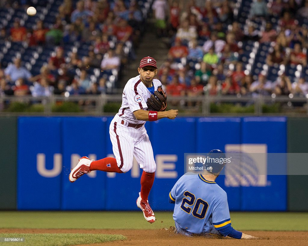 Cesar Hernandez #16 of the Philadelphia Phillies turns a double play against Jonathan Lucroy #20 of the Milwaukee Brewers in the top of the eighth inning at Citizens Bank Park on June 3, 2016 in Philadelphia, Pennsylvania. The Phillies defeated the Brewers 6-3.