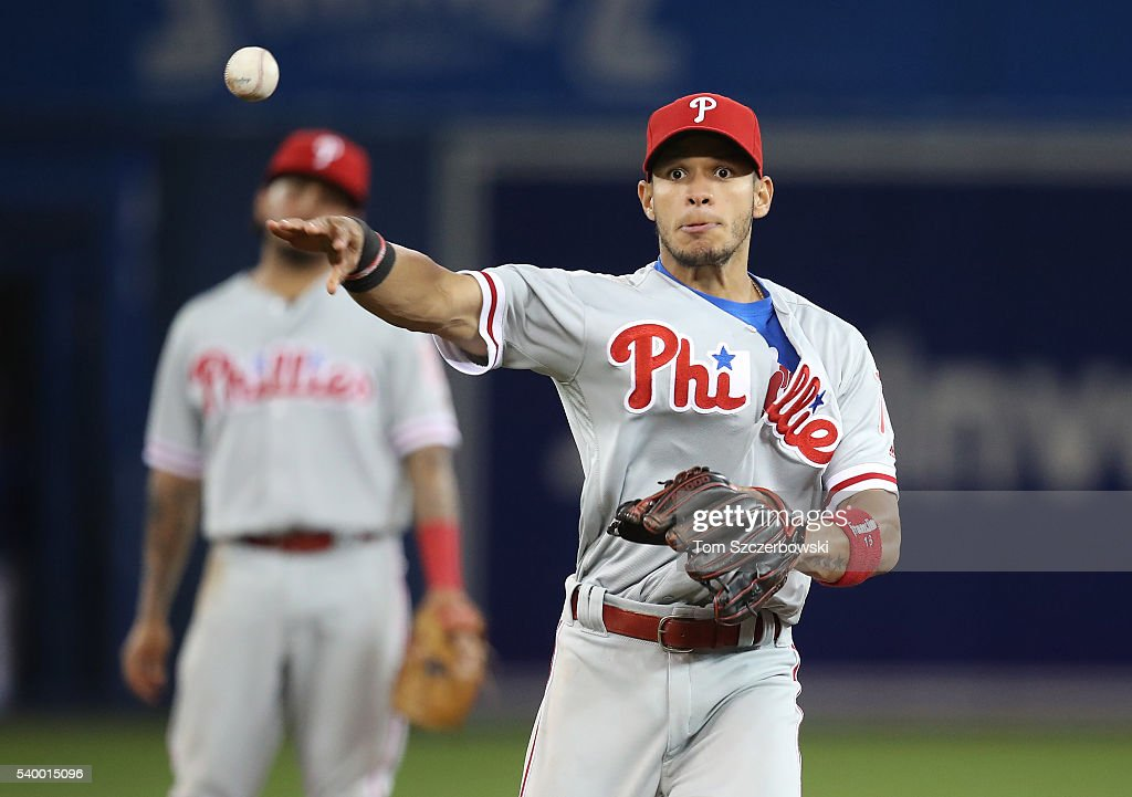 Cesar Hernandez #16 of the Philadelphia Phillies turns an unassisted double play in the ninth inning during MLB game action against the Toronto Blue Jays on June 13, 2016 at Rogers Centre in Toronto, Ontario, Canada.