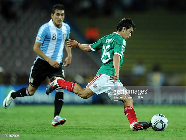 Cesar Ibanez of Mexico strikes the ball besides Carlos Orrantia of Mexico during the FIFA U20 World Cup Colombia 2011 group F match between Argentina...