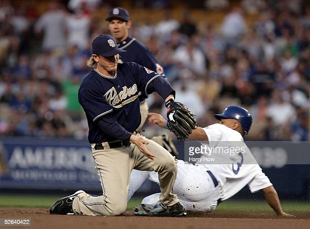 Cesar Izturis of the Los Angeles Dodgers steals second base in front of shortstop Khalil Greene and second baseman Mark Loretta of the San Diego...