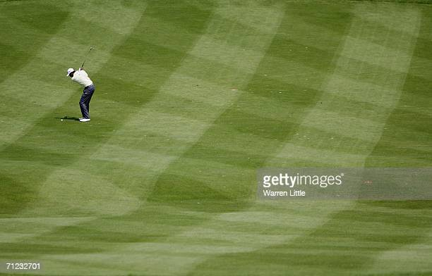 Cesar Monasterio of Argentina plays his second shot on the 13th hole during the final round of the AA St Omer Open at the St Omer golf club on June...