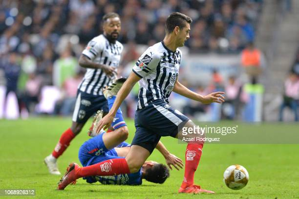Cesar Montes of Monterrey drives the ball while Angel Mena of Cruz Azul lies on the ground during the semifinal first leg match between Monterrey and...
